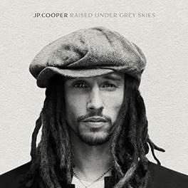 """Ouça """"Raised Under Grey Skies"""", primeiro álbum de estúdio de JP Cooper!"""
